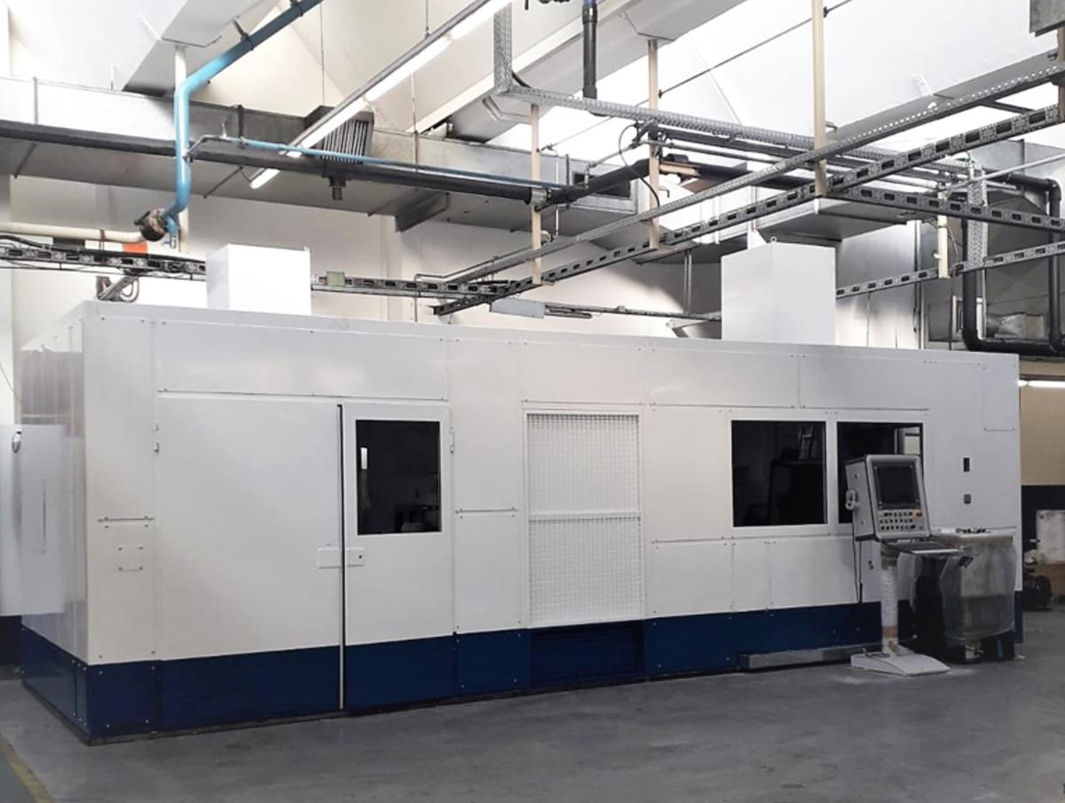 Sound enclosure for forging machine